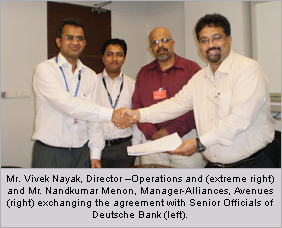 Mr. Vivek Nayak, Director –Operations and (extreme right) and Mr. Nandkumar Menon, Manager-Alliances, Avenues (right) exchanging the agreement with Senior Officials of Deutsche Bank (left).